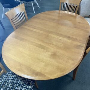 round Birch wood table, oval with leaf leg table with 4 chairs. upholstered seats with slat wood back. Custom options available but this displayed dining set is as is and can be taken home today